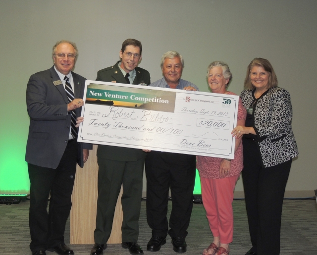 From left: James Tolbert, Business Administration assistant professor; 2013 New Venture champion Robert Bibbo; Dave Bear, president of JB Tool, Die & Engineering, Inc., and New Venture sponsor; Mary Bear, Dave Bear's wife; and Jerrilee Mosier, Ivy Tech Northeast chancellor.