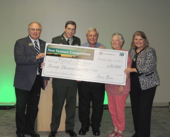 From left: James Tolbert, Business Administration assistant professor; 2013 New Venture champion Robert Bibbo; Dave Bear, president of JB Tool, Die & Engineering, Inc., and New Venture sponsor; Mary Bear, Dave Bear's wife; and Jerrilee Mosier, Ivy Tech Northeast chancellor