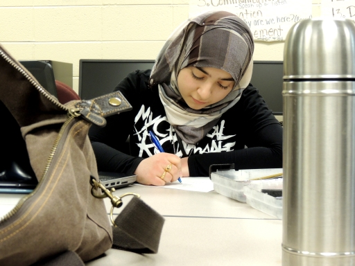 Ivy Tech Northeast ASAP student Fatima Al Timeemy writes a pen pal letter to third graders at West Noble Elementary in Ligonier.