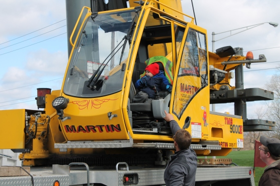 A child sits in a crane from 2013's Touch-A-Truck event at Ivy Tech Community College Northeast.