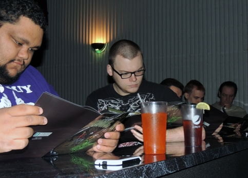 "Chris Harbin, center, a member of the Ivy Art Society, and other students see ""Finding Ivy"" in print for the first time. Students received these copies at a party to celebrate the graphic novel—a viewing of ""The Amazing Spider-Man 2"" at the Cinema Grill on Wednesday afternoon."