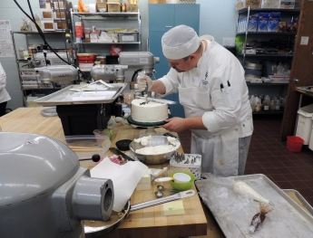Anthony Flanagan, a baking and pastry student at Ivy Tech Northeast, decorates a cake for the 2015 European Competition. Flanagan was one of eight students selected to travel to France and Spain to study the culinary arts.