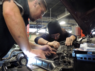 Ivy Tech Northeast automotive technology students Kyle Thomas and Tabitha McCord put a timing chain on McCord's car. The College's Automotive Technology program has just received reaccreditation from the National Automotive Technicians Education Foundation, the educational branch of the industry's standard accreditation group, the National Institute for Automotive Service Excellence.