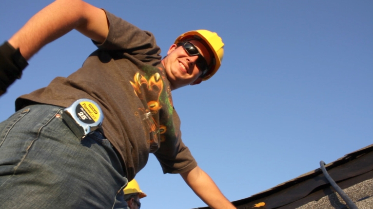 Construction technology major Joshua Willman Constributes to an Ivy Tech Northeast class project to reroof a model structure at Fort Wayne's Safety Village last fall.