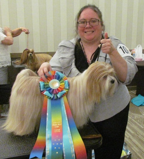 Rambo with Pippa at the Lhasa Apso National Specialty dog show in St.  Lous, Mo. Pippa had just received her Champion title ribbon.