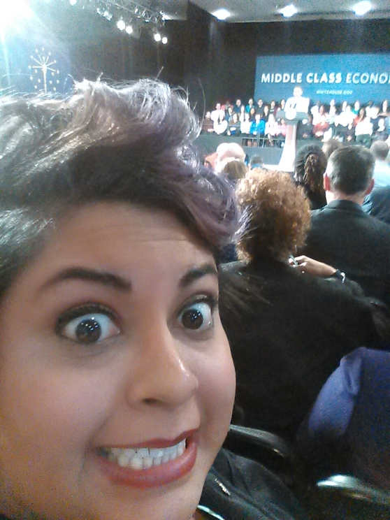 REALLY excited selfie with the president at the podium