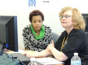 Ivy Tech Northeast accounting instructor Gail Amstutz (right) assists Fort Wayne resident Tameka Brown file her tax returns electronically. Amstutz is the College's site coordinator for the IRS-sponsored Volunteer Income Tax Assistance program, or VITA.