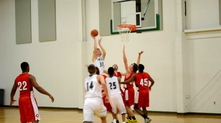 The Ivy Tech Titans (white) face off against the Grace College All-Stars in the Student Life Center Gymnasium on Feb. 17. Ivy Tech Northeast began sanctioning club sports in 2015, beginning with basketball, as another means to increase student persistence and graduation rates.
