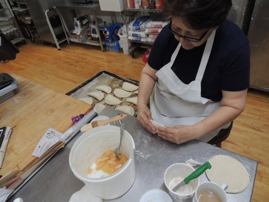 Hernandez owns Zinnia's with her mother, Aracely Vega. Here, Vega makes apple empanadas.