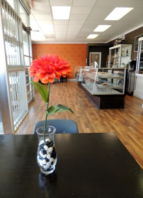 Faux zinnias brighten up the seating inside Zinnia's Bakehouse.