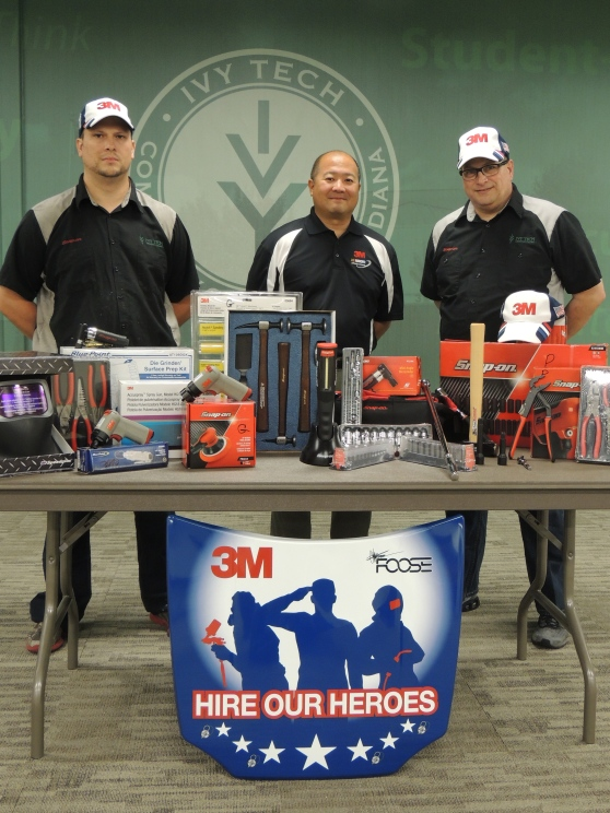 Ivy Tech Northeast automotive technology student Gabriel Davis (left) and graduate Paul Hyde (right) display $3,000 in tools and equipment that each individual selected as a recipient of the Collision Repair Education Foundation's 3M Hire Our Heroes tool grant for 2015. Both men are joined by Randy Minobe, senior account representative with the 3M Automotive Aftermarket Division. Davis served in the Indiana Army National Guard for nearly eight years, and Hyde served in the U.S. Army for five years. From among the 35 tool grants awarded nationwide this year, Ivy Tech Northeast was one of only two colleges to have more than one recipient.