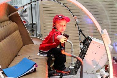 Dylan Raymond, grandson of airframe instructor Brad Stark, enjoys a moment of exploratory fun during the donor recognition event on April 17.