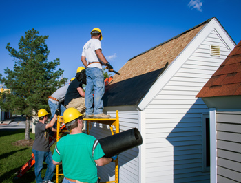 Fall 2014 construction technology students reshingle a roof for a Safety Village structure.