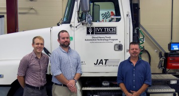 JAT of Fort Wayne has donated a semi-truck with a Detroit diesel engine, which allows Ivy Tech Northeast to begin offering diesel classes in spring 2016. From left: Automotive technology instructors David Jones and Nick Goodnight and automotive technology program chair Robert Huffman.