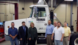 From left: Automotive technology program chair Robert Huffman; technology division dean Darrel Kesler; Chancellor Jerrilee K. Mosier; JAT co-owners Jared Thompson and Jim Thompson; JAT shop manager Brian Arnold; and JAT maintenance manager Jim Minser.