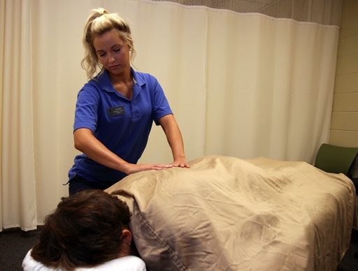 Allie Bowman works on a client in fall 2015 at Healthy Essence, the Ivy Tech Northeast massage clinic run by therapeutic massage students.