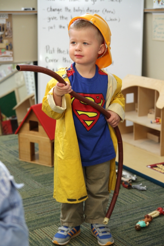 Preschooler Winston Unger, 3, prepares to confront a pretend fire.