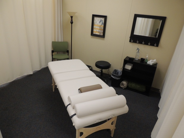 "Each of the four ""rooms"" has the massage table, some hooks and a chair for hanging your folding your clothes, and tissues. Blankets are stored beneath the bed if the sheet leaves you too cold."
