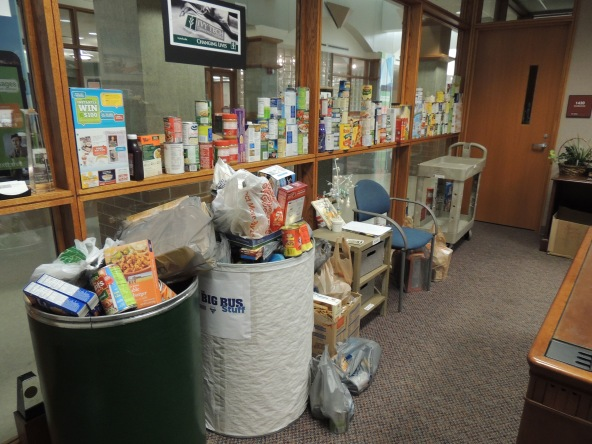 Bus Stuff is a community collaboration to collect nonperishable food for Community Harvest Food Bank. Ivy Tech Northeast collected the most food of the partners. Food overflowed from the collection barrels in bags and along windowsills.