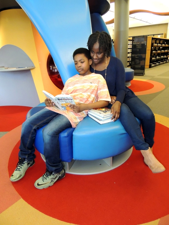 Ivy Tech Northeast alumna and Student Success instructor Odessa Aytch enjoys some leisure time with her son, Kashani, 9, at the Allen County Public Library's main branch.