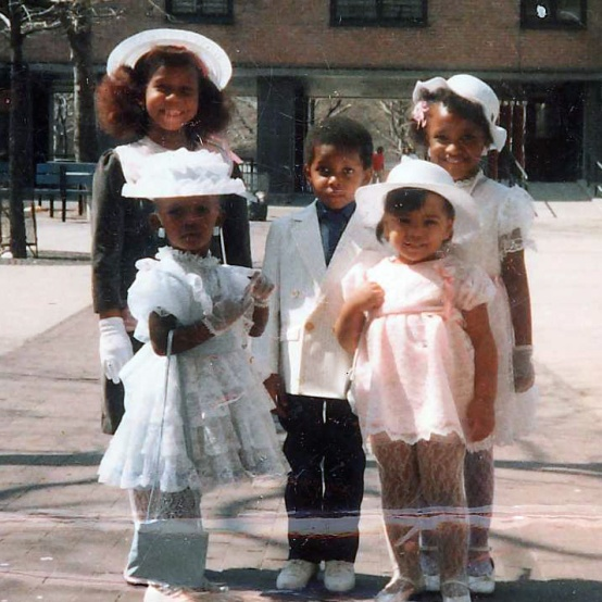 Aytch (back row, right) with her sister (front row, left) and cousins at Easter in 1988