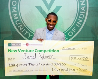 Jamal Robinson, an Ivy Tech Northeast alum, won the 2016 New Venture Competition with his business, DESIAR Eyewear. With his winnings, he plans to launch the Hoosier line of glasses, made with cherry wood.