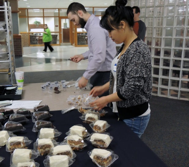 Kyle Hyland and Hay Maung, Case Problems in Business students, package samples of chocolate and carrot cake in Crescent Commons.