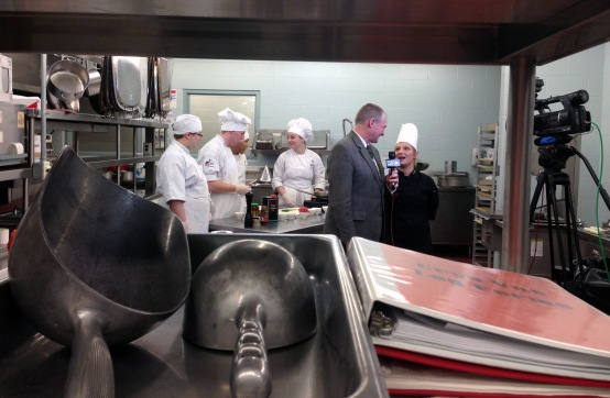 Kent Hormann with Fort Wayne's NBC interviews hospitality instructor Sarah Hughes while students prepare ahi poke.