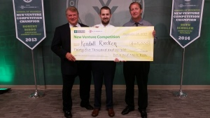 Kendall Ricken after winning the 2017 New Venture Competition. From left: SCORE mentor Billy Mitchell, Riecken, and Riecken's father